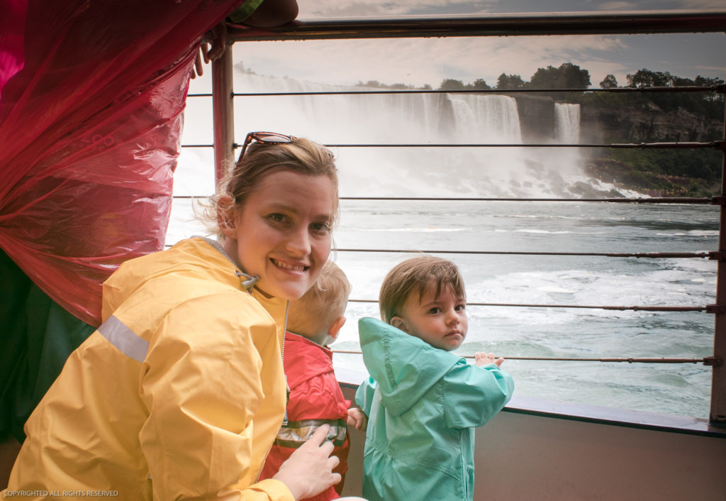 Mother poses with two toddlers aboard the hornblower cruise at niagara falls