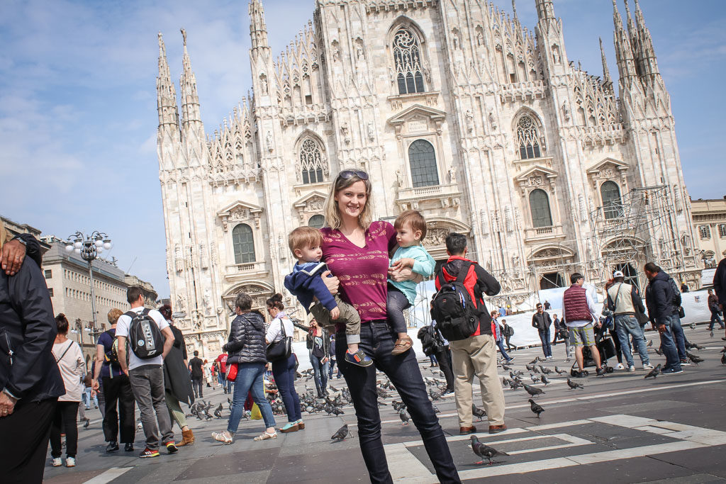 Mom poses with twin toddlers in Milan in front of the Duomo Di Mlano - which is completely crooked in the background, but at least both 1 year olds are in the frame right?