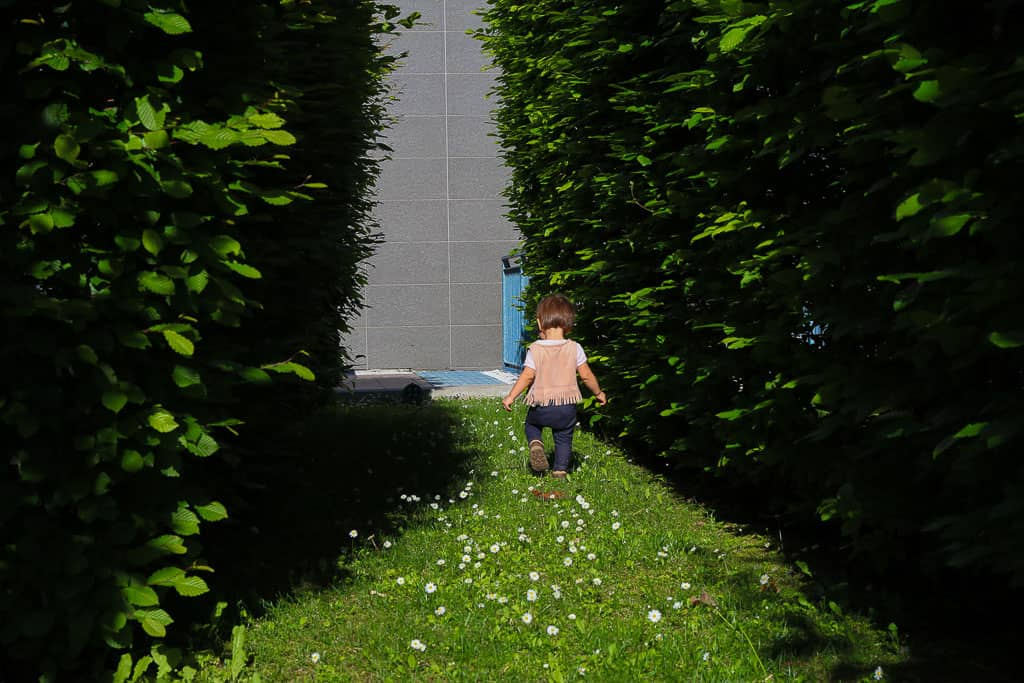 Photo of young girl exploring the community green space at Ramada Plaza Milan. Hotel review Milan , Italy