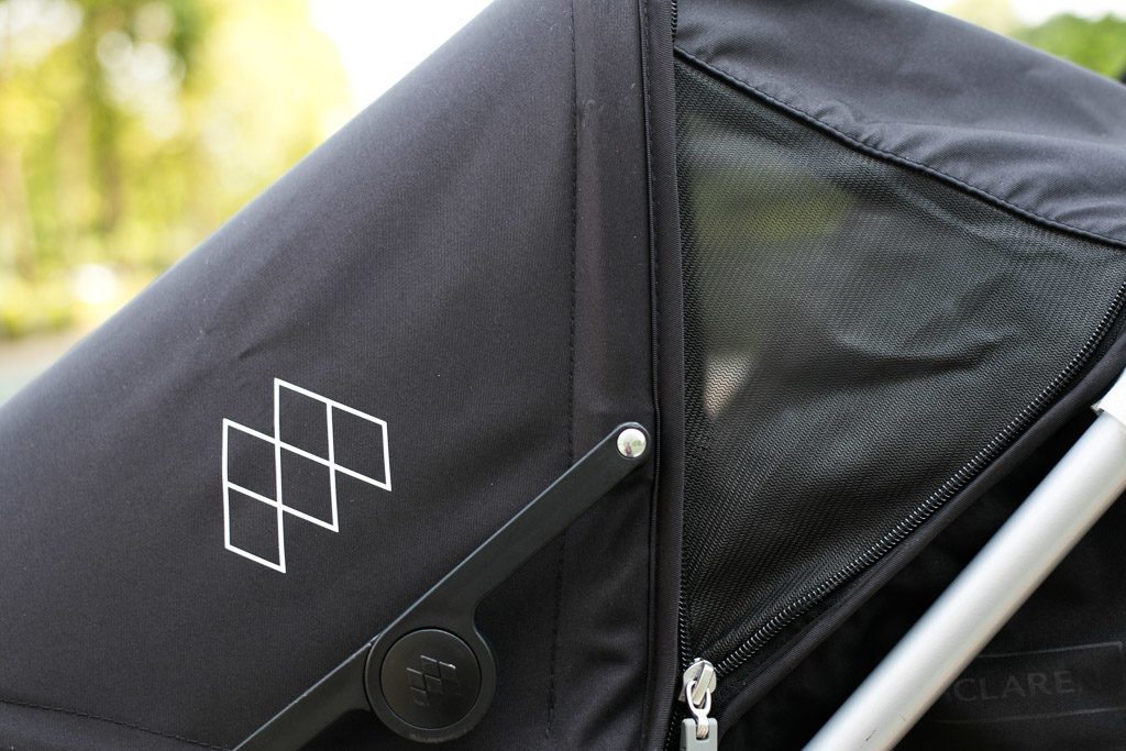 Showcasing the mesh sides on the best double umbrella stroller for travel.