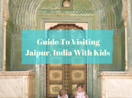 Twin toddlers pose in doorway at City Palace - Jaipur.