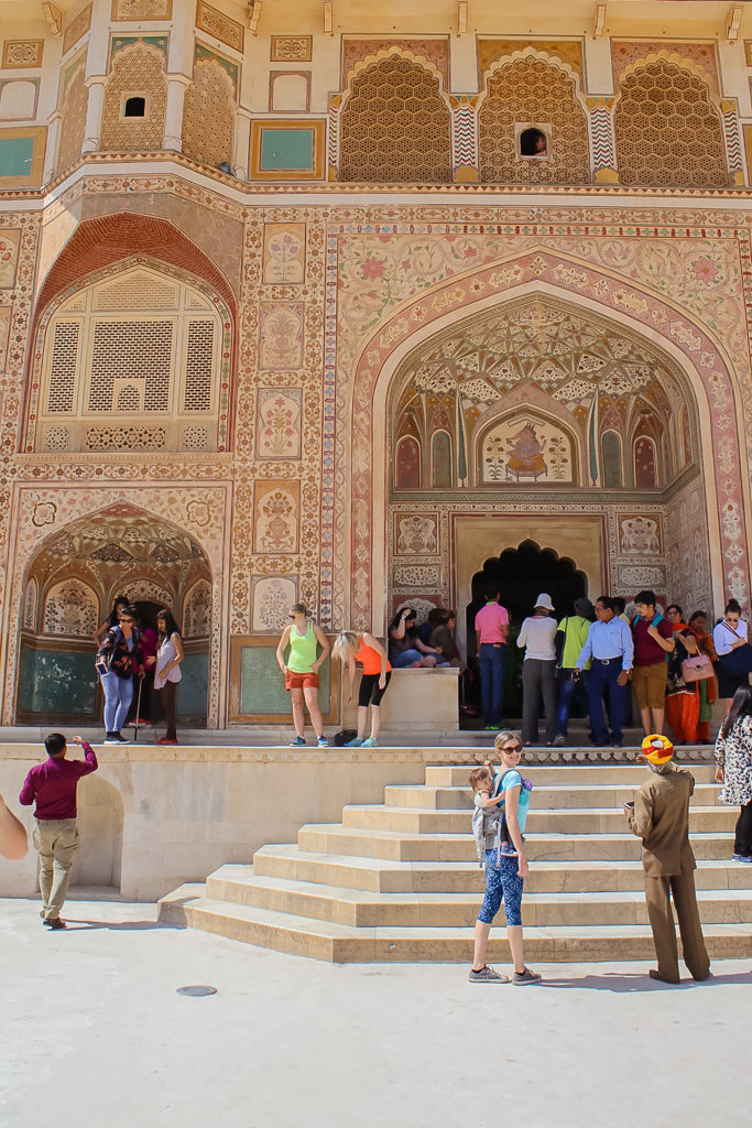 Amer fort, stairway to hall of mirrors. - baby wearing my toddler on my back - things to do in Jaipur