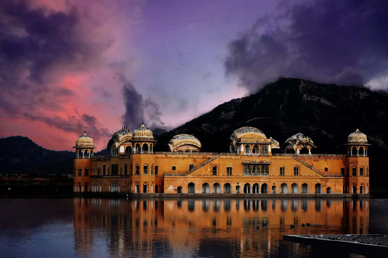 The Floating Palace Jal Mahal at dusk with cloudy skies. Curtesy of Ravi Shekhar via unsplash - Open copyright