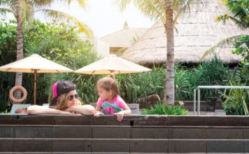 Mother and daughter hang out in a pool in Bali