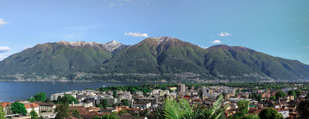 View of lake, mountains and town of Locarno. Perfect destination when travelling with kids.
