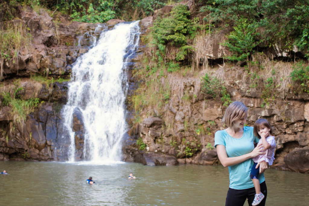 Mother and daughter stand at Waimea falls. Hawaii with kids