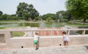 Two toddlers admire the view in one of the best parks in delhi