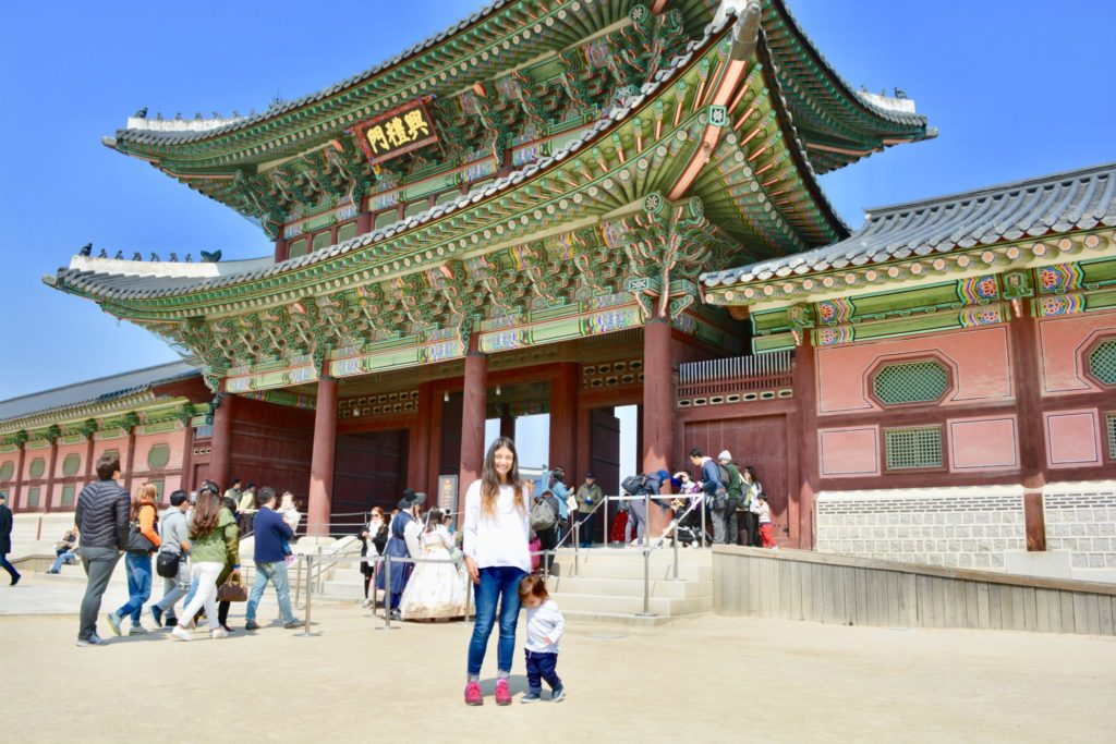 Mother and toddler pose in front a temple in Seoul. Plenty of fun places and tourist attractions to take the kids. places to take toddlers