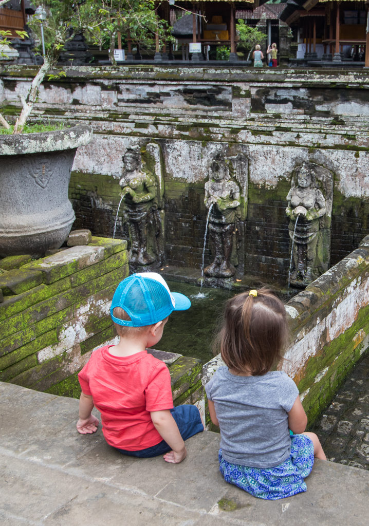 Two toddlers sit and enjoy the view in Ubud, Bali. A great stop if you're visiting Bali with Toddlers