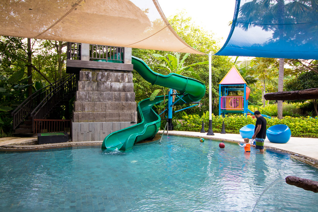 Kids pool at the Ritz Carlton Bali is empty except for a father with his twin toddlers