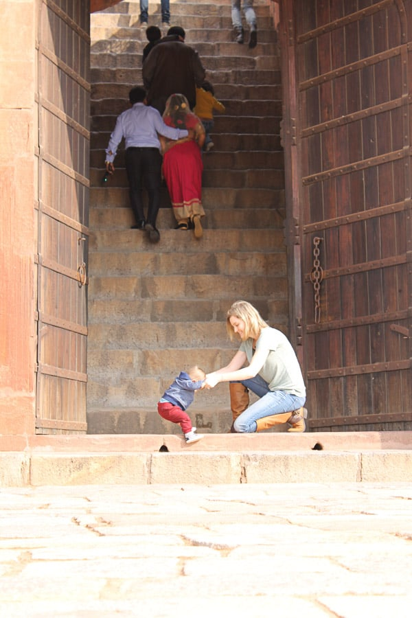 Baby learns to walk in historical site. New Delhi, India