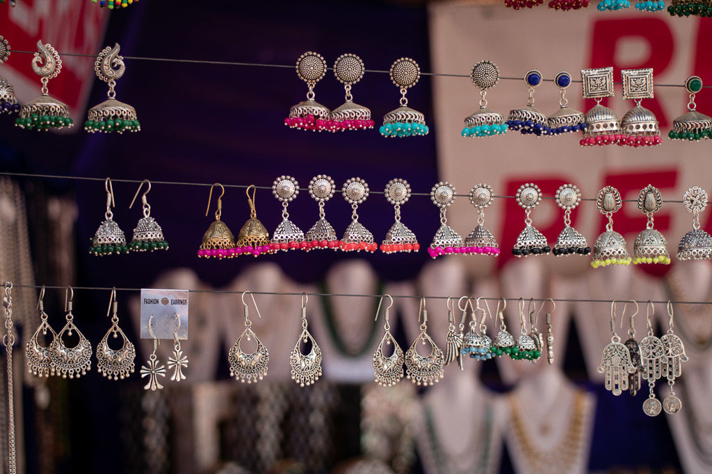 Indian style earrings on display - you will want to learn how to haggle to get a great price on these.