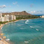 Stretch of Waikiki Beach with view of Diamond head. Kid friendly beaches Oahu