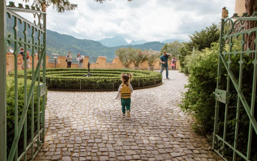 Toddler runs around the Castle grounds at fairy tale castle Germany