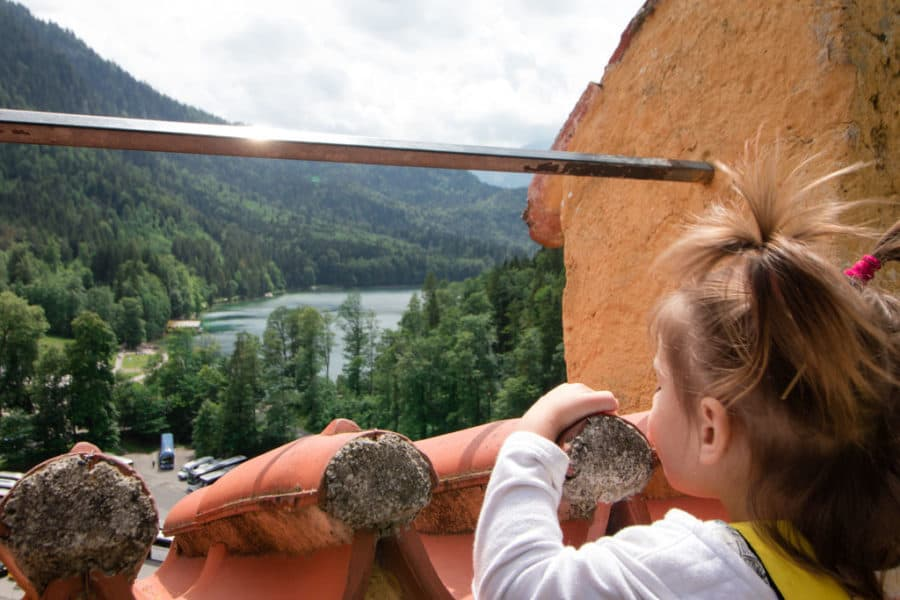 Toddler takes in the fairy tale view at Hohenschwangau Castle
