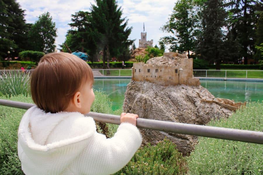 Toddler looks at mini Italy display at Leolandia