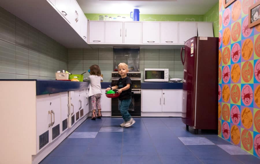 Toddlers play in the kitchen at Kidzania, Noida