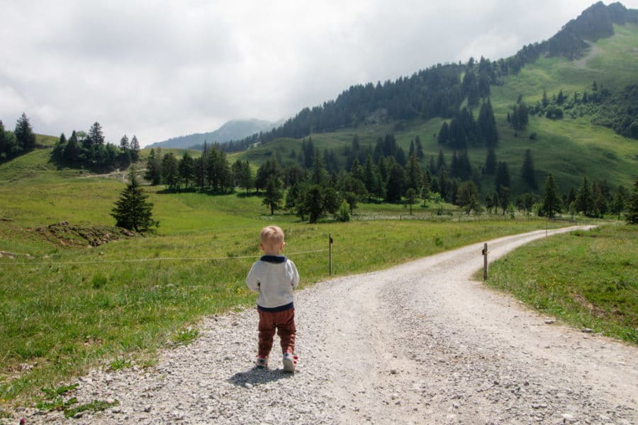 Boy walks along a hiking trail sin stoos switzerland