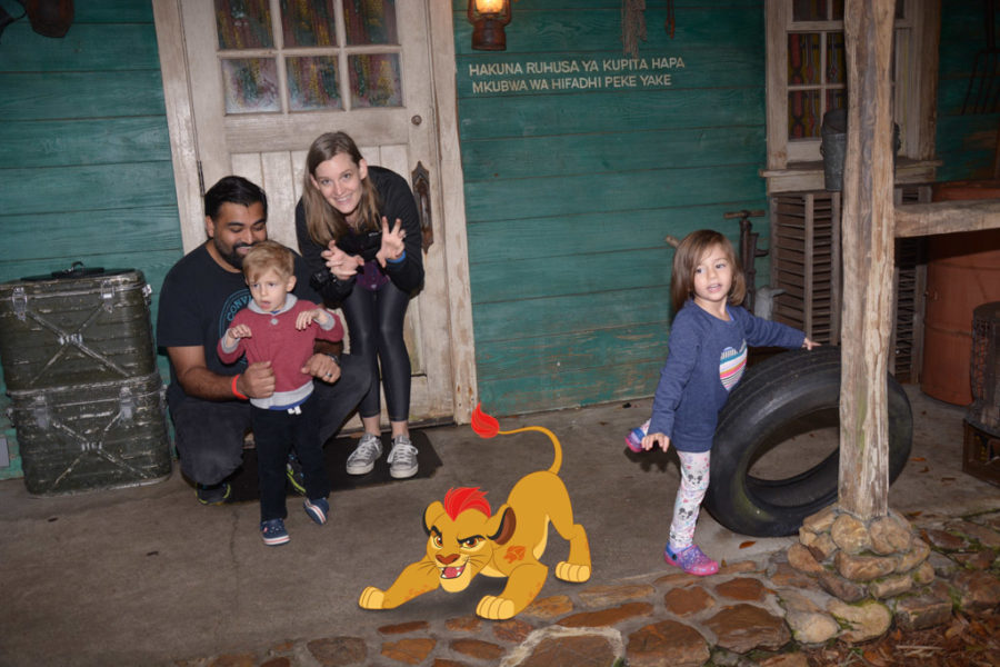Family poses with fake lion.