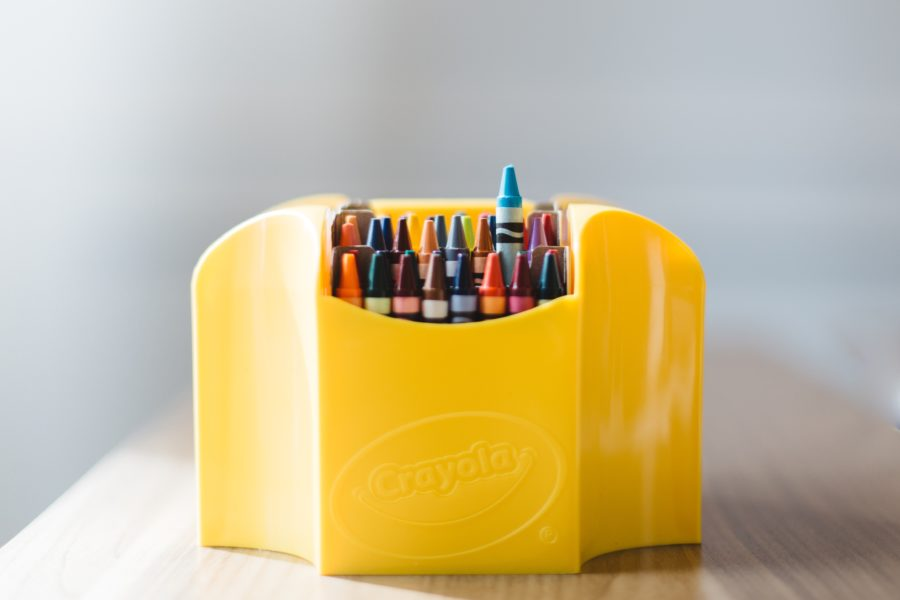 Yellow box of Crayola crayons. Plane toys for toddlers.