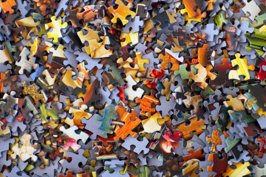 Toy puzzle pieces scattered on the floor