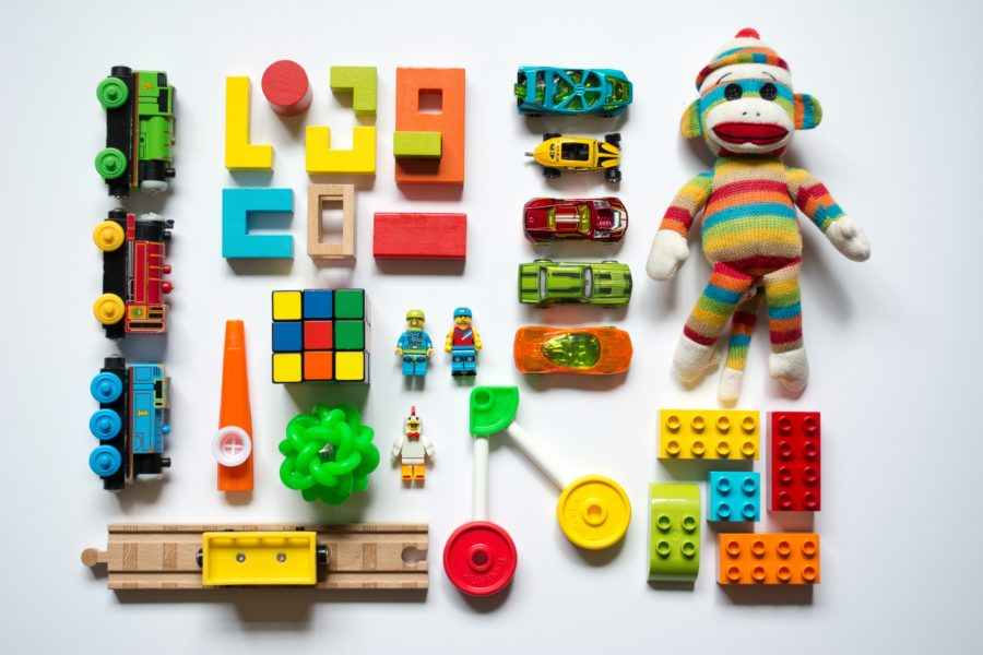 Collection of airline toys for toddlers laid out on a white background.
