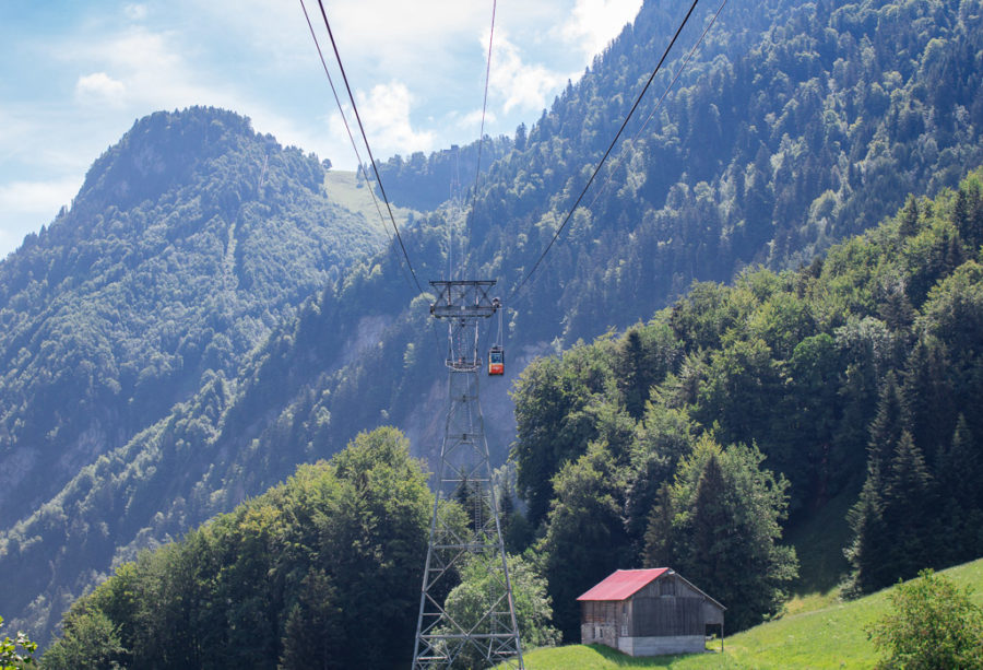 Red gondolas make their way up the mountainside.
