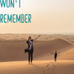 Mother and toddler walk in Dubai desert during a family holiday