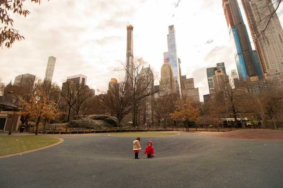 Two toddlers play in central park.