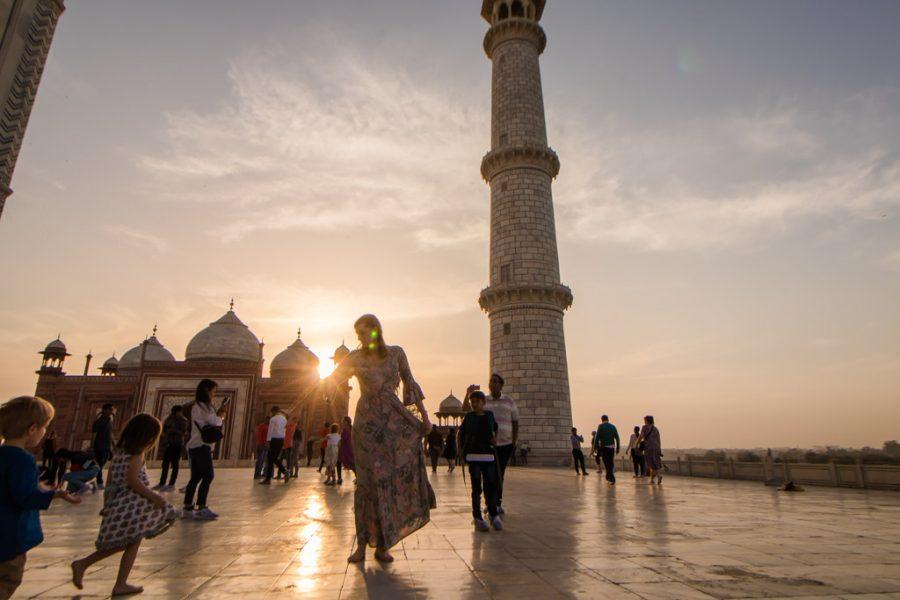 Woman walks around Taj Mahal barefoot