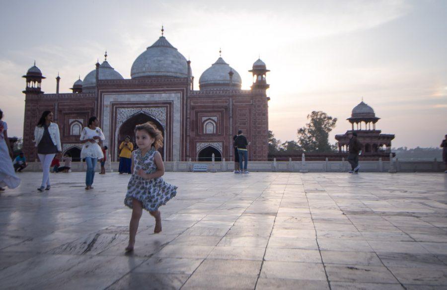 Toddler runs around Taj Mahal