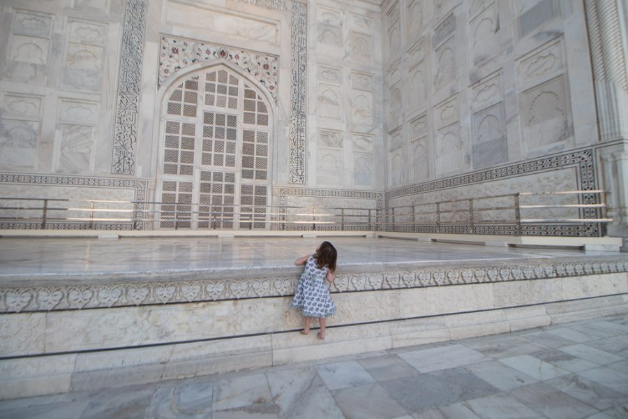 Toddler climbs a ledge at the Taj Mahal in Agra.