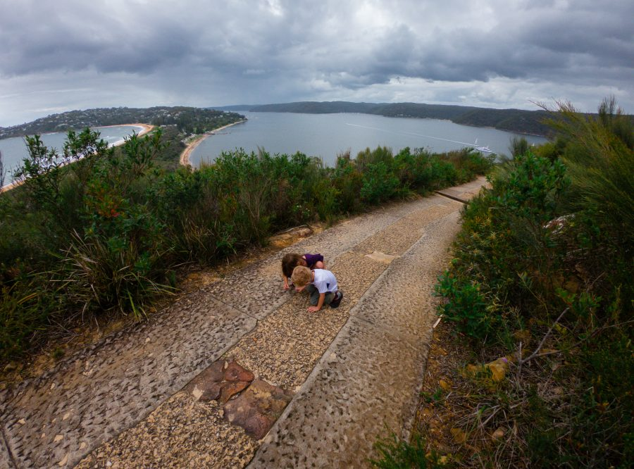 Two children walk along the Barrenjoey lighthouse walk