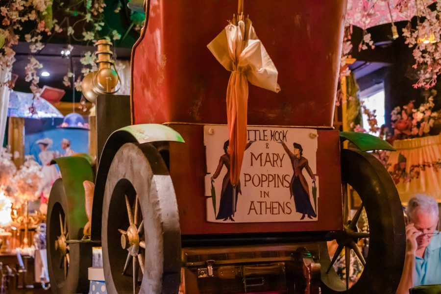 "Red carriage with sign displaying ""Mary Poppins comes to Athens"""