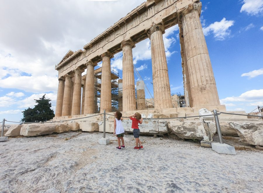 Children stare upwards at the Acropolis in Athens
