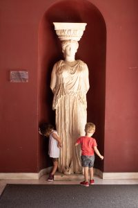 Children admire an acient statue outside of the Acroplis Museum