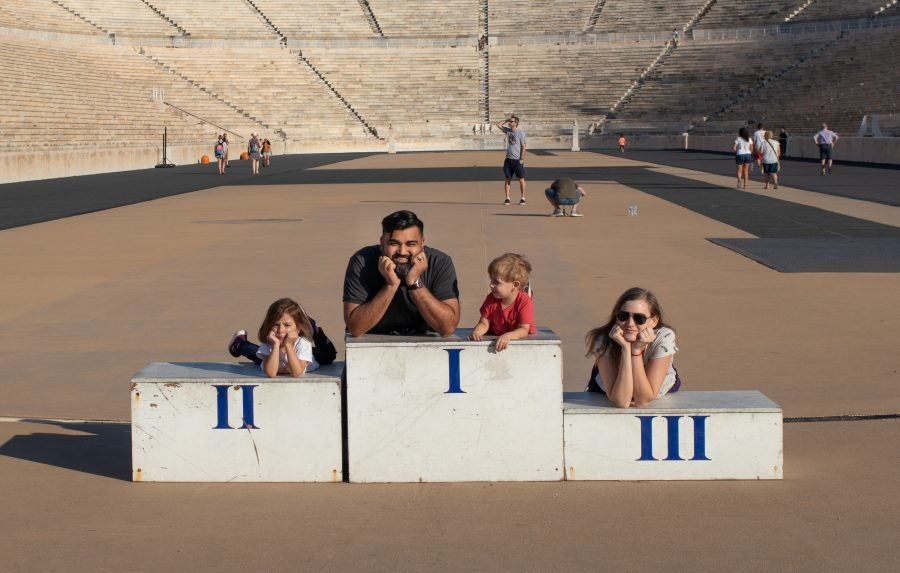 Family poses on the winners stadium in Athens, Greece
