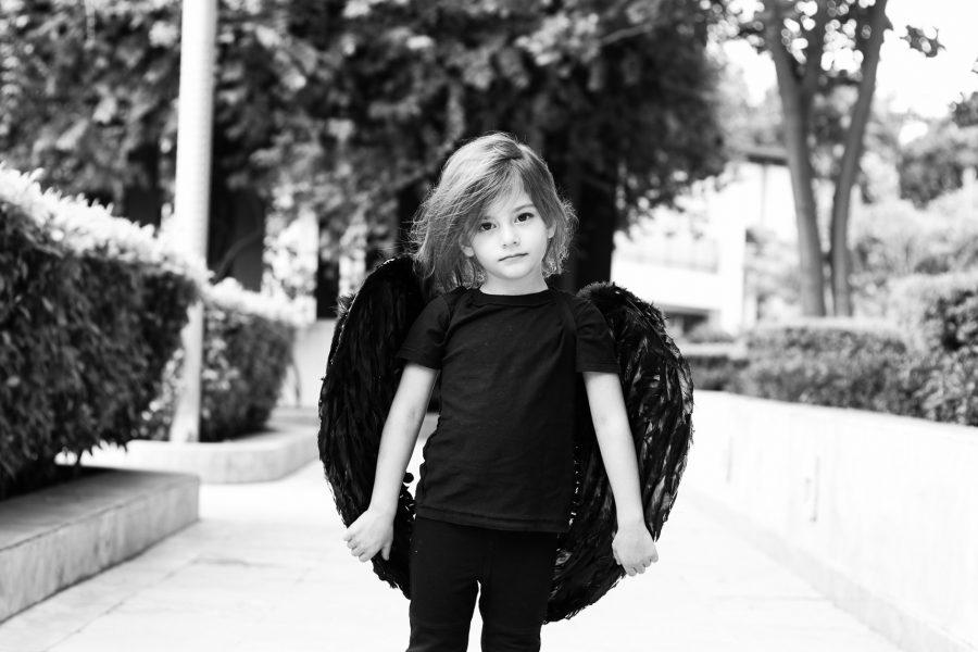 Girl dresses up like a fallen angel.